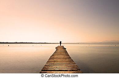 Jetty - Man standing on a small jetty, enjoying the sunset...