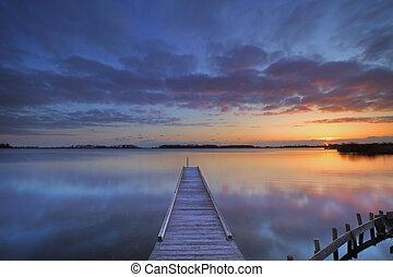 Jetty on a lake at sunrise, near Amsterdam The Netherlands