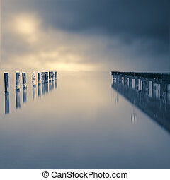 Jetty on a lake with dramatic sky