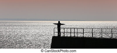 jetty on the ocean at sunset