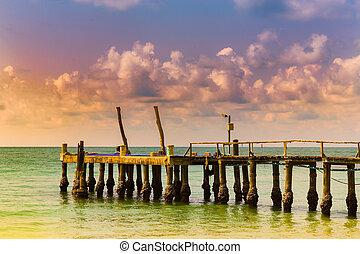 Jetty over seacoast skyline sunset tone