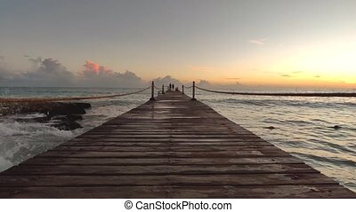 Jetty over the sea at sunset