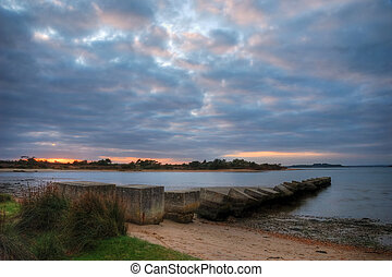 Remains of a concrete jetty in Poole Harbour, Dorset (UK)