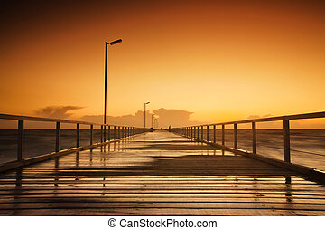 Beautiful sunset over a long jetty