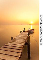 Jetty sunset over the ocean