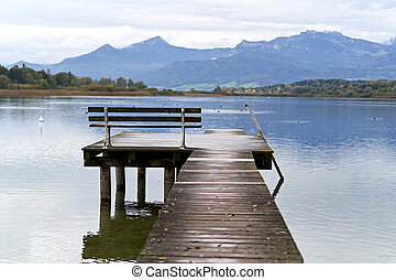 Jetty with a bench in a lake