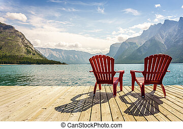 Jetty with chairs by Minnewanka Lake, Alberta, Canada