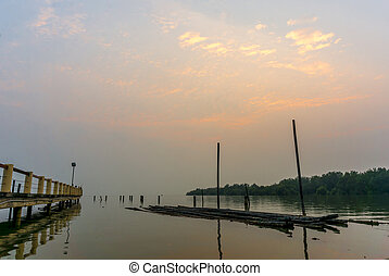 Jetty with sunset skies in evening scene