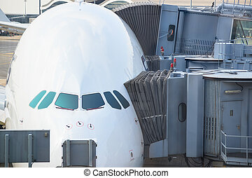 Jetway bridges and airplane waiting boarding