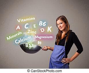 jeune femme, cuisine, vitamines minéraux