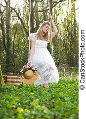 jeune femme, dans, robe blanche, séance, sur, a, balançoire, dehors
