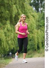 jeune femme, jogging, dans parc