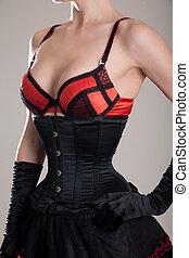 jeune, sexy, femme, dans, noir, corset, et, rouges, soutien gorge