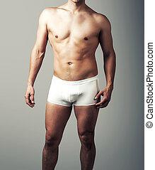 jeune, sexy, homme, poser, dans, blanc, pants.