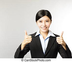 jeune, sourire, femme affaires, à, pouce haut, geste