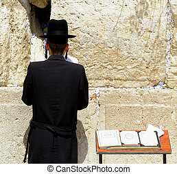 jew praying - young hasidic jew at the wailing western wall,...