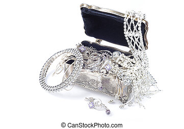 Metal jewelry open box with accessory on whitee background