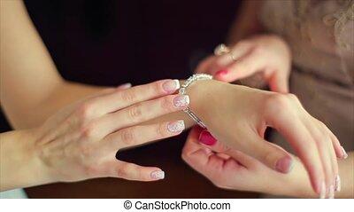 Jeweler Bracelet on the Bride's Hand Wearing