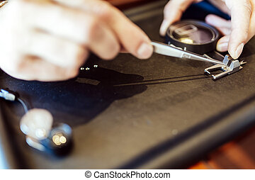 Jeweler checking size of diamond - Jeweler checking diameter...