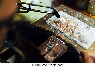 Jeweler crafting jewelry on his workbench