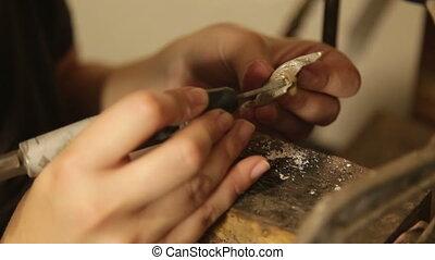 Jeweler grinding copper