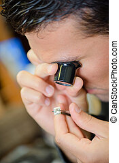 Jeweller appraising a ring