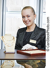 Portrait of smiling female sales assistant in jewelry shop