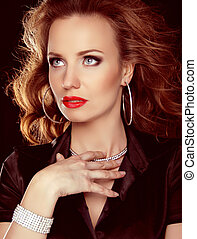 Jewelry and Beauty. Beautiful woman with curly hair and evening make-up. Fashion art photo