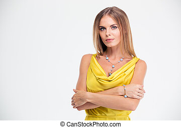 Attractive woman standing with arms folded