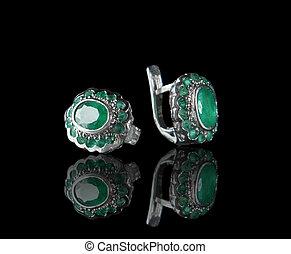 vintage earrings on black background