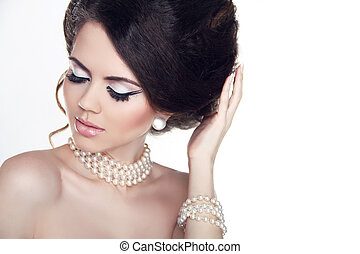 Jewelry and Makeup. Fashion portrait of beautiful woman with pearls isolated on white background.