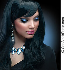 Jewelry. Beautiful Brunette Girl with Holiday Makeup