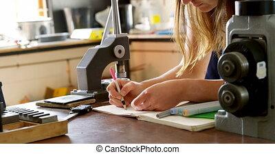 Jewelry designer drawing sketch on register 4k - Female...