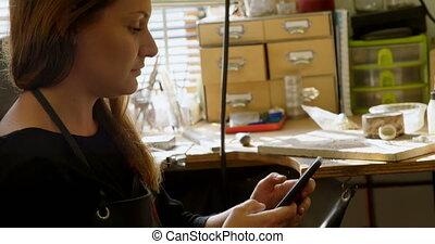 Jewelry designer using mobile phone 4k - Jewelry designer ...