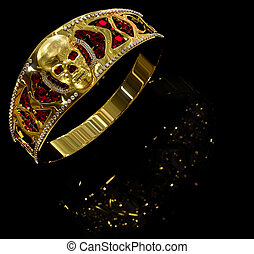 Jewelry gold skull ring with diamond and red ruby gems.