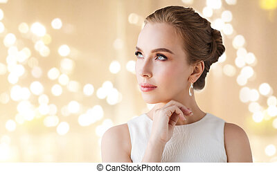 woman in white dress with diamond earring