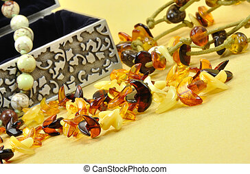 Jewelry Made of Amber on Golden Background