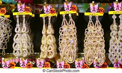 Jewelry market with earrings and beautiful bijouterie. ...
