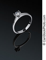 Ring with diamonds on dark background