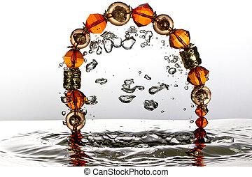 Jewelry splash with water