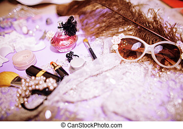 Jewelry table with lot of girl stuff on it, little mess in...
