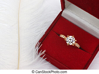 Jewelry wedding ring with diamond in gift box on white