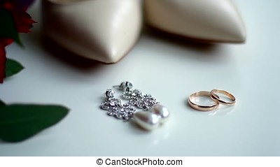 Jewelry with pearls and gold on a white background.