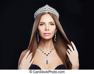 Jewelry woman with diamond necklace, crown and silver earrings on black background