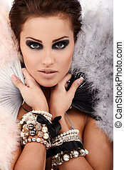 Jewelry - Young brunette lady with luxury accessories...