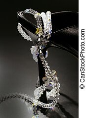 jewels around a fashion black shoe heel - jewel necklace...