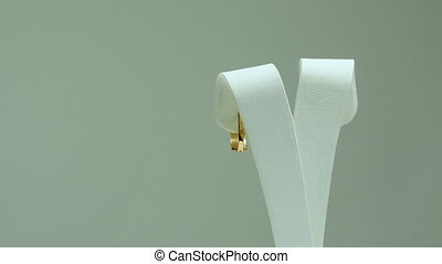 jewerly gold ear-rings turquoise color on white background