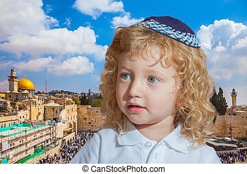Jewish child in a blue skullcap - Little boy with long blond...