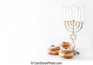 Jewish Hanukkah menorah and sufganiyot donuts isolated on white background.