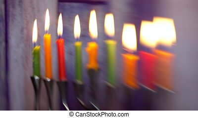 Jewish holiday hannukah symbols - menorah defocused lights...
